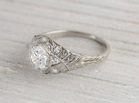 Gorgeous Art Deco vintage engagement ring made in platinum and centered with a .85 carat GIA certified old European cut diamond with J color and VS2 clarity. Circa 1920 Center diamond is prong set inside a hexagonal setting and accented with single cut diamonds in a classic deco setting decorated with millegrain edges. Beautiful deco lines in this 1920′s find. Learn more about Art Deco rings Diamond and gold mining has caused devastation in areas such as Africa, wreaking havoc on delicate…