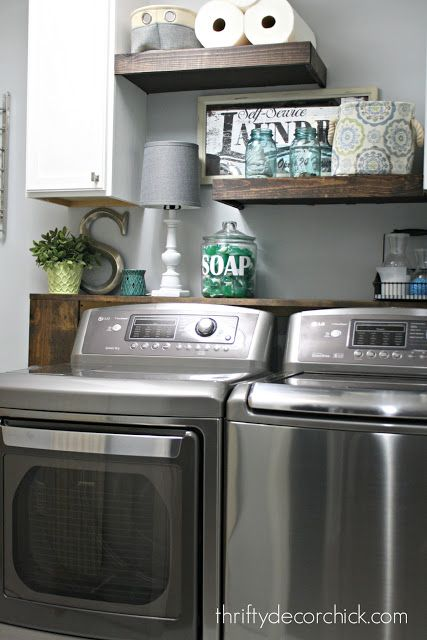 The power of paint! - Great idea of adding a shelf and lamp just behind washer & dryer.