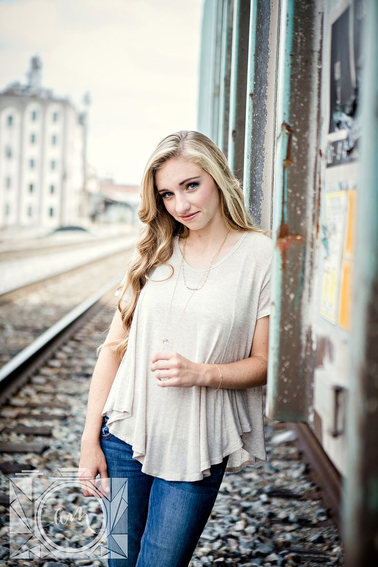 Leaning shoulder against train senior pictures in downtown knoxville by Amanda May Photos