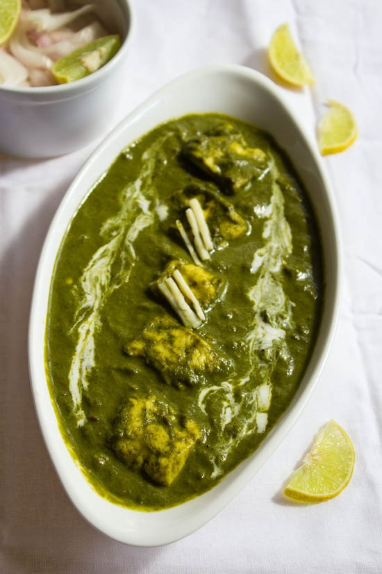 palak paneer – one of the most popular indian dish. soft cottage cheese cubes cooked in a smooth spinach curry. http://www.vegrecipesofindia.com/palak-paneer/ #paneer #spinach #cottagecheese #paneerrecipes #palak #recipes