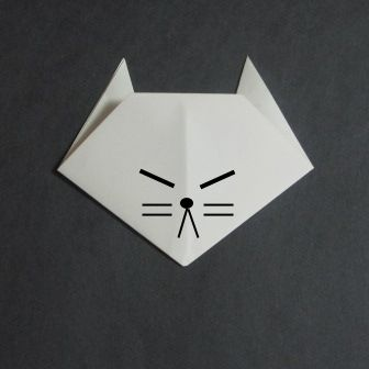 Origami cat face.....F had so much fun making!  easy for little kids to do