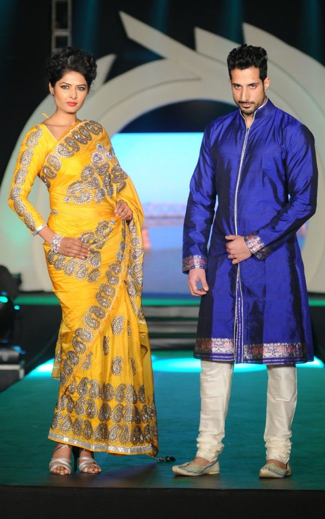 Rohit Verma long sleeved yellow sari blouse and blue men's sherwani. More photos - http://www.indianweddingsite.com/marigold-watches-rohit-verma-fashion-show/