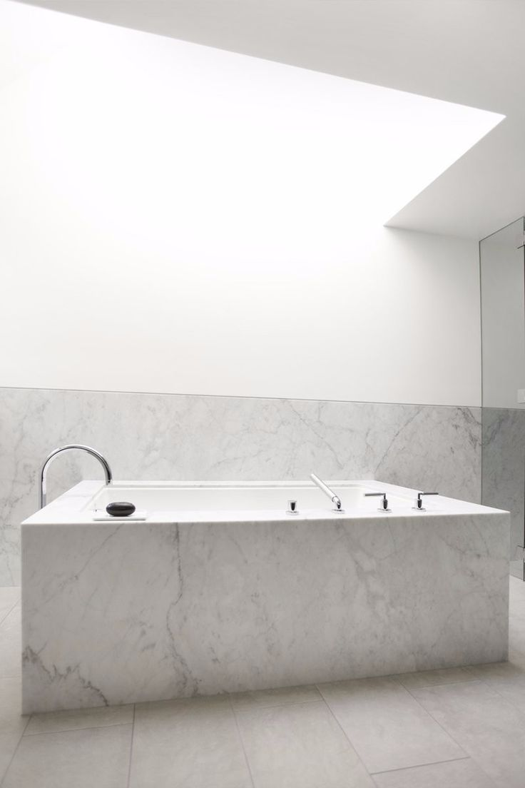 Simple but charming bathtub with a square bathtub design by Nicole Hollis.