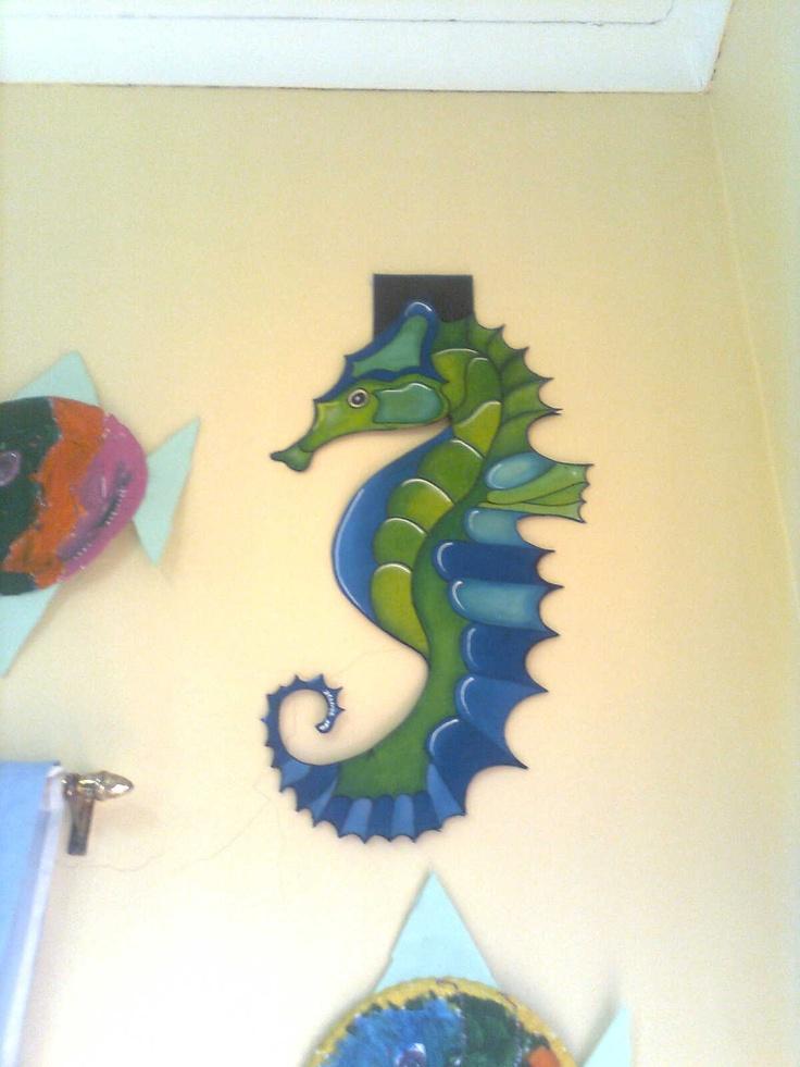 Seahorse painted on fabric and then glued to cardboard.