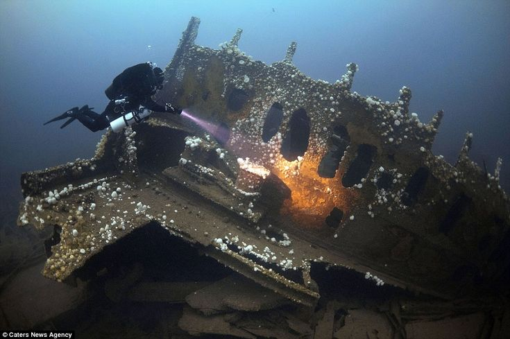 A diver exams the wreck of SS Justicia which was torpedoed by the German U-Boat UB-124 killing 16 men. It was one of the largest ships sunk in the First World War