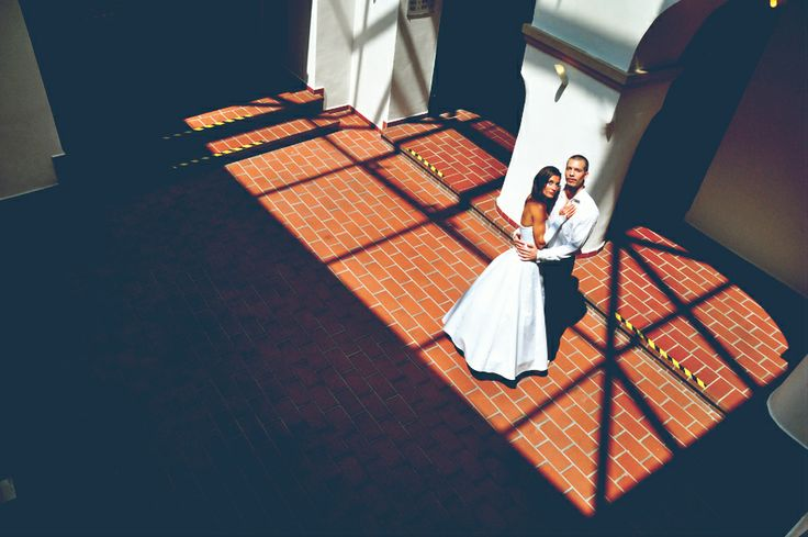 couple in a hotel, nice,  geometric shadows on the ground