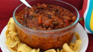 A straight-forward chili with ground beef, canned kidney beans and chili powder simmered with crushed tomatoes for under an hour.