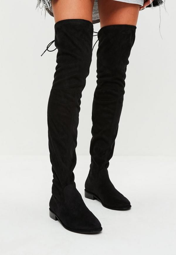 these over the knee boots feature a faux suede fabric, black hue and tie details to the back.