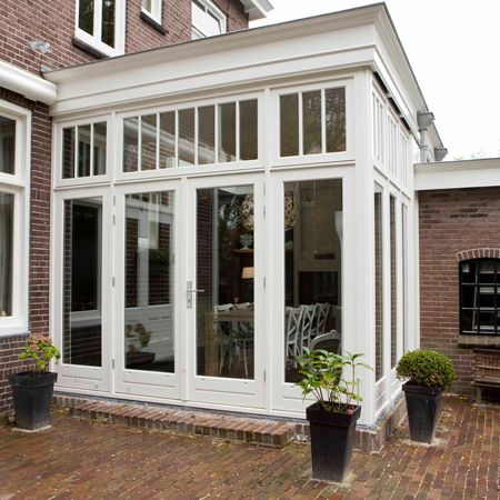 sunroom on house with brick siding