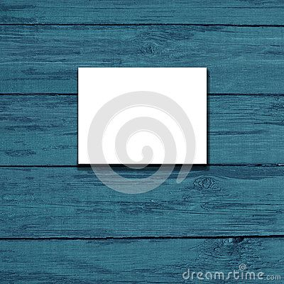 White canvas frame on a  blue wooden background.