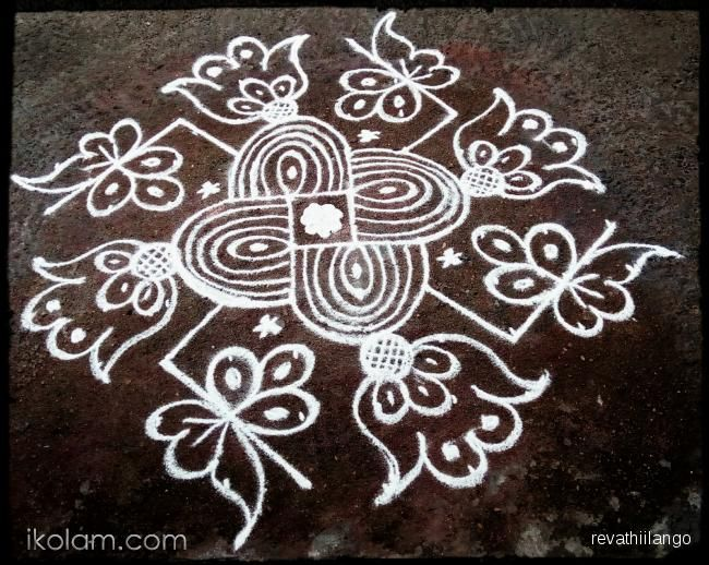 Rangoli Rev's new try swastik kolam for friday. 10 dots 2 lines end with 2 dots. | www.iKolam.com