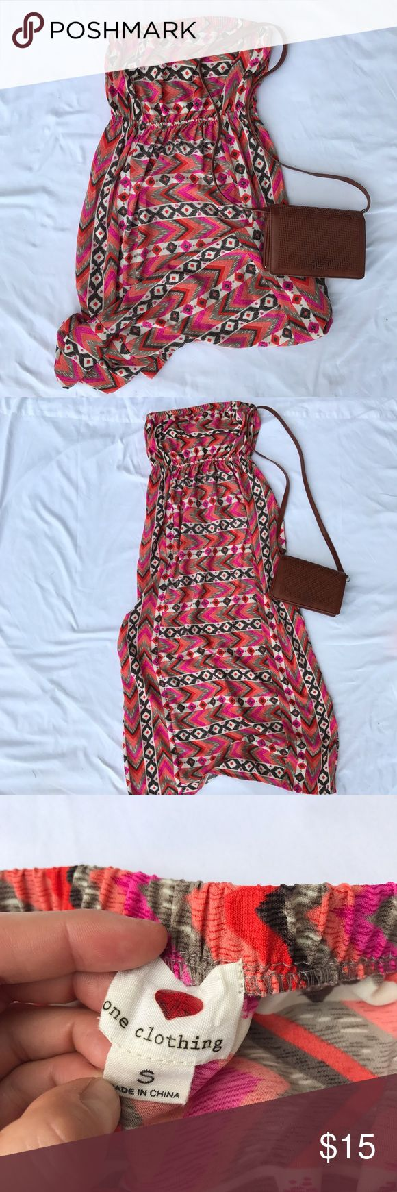 Strapless MAXI dress with pink and orange tribal Flattering pink and orange strapless maxi dress. The elastic waist line makes this dress more fitted. The print is the same on both sides. Excellent used condition. one clothing Dresses Maxi