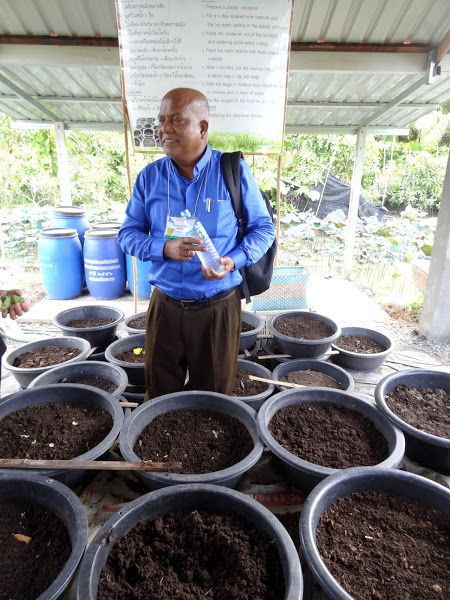A pastor  from Bangladesh at an organic farm in Thailand looking at their worm composting. He's passionate about churches getting involved in creation care because they are already seeing the impacts of climate change in his nation. Photo by Brian Kaylor.