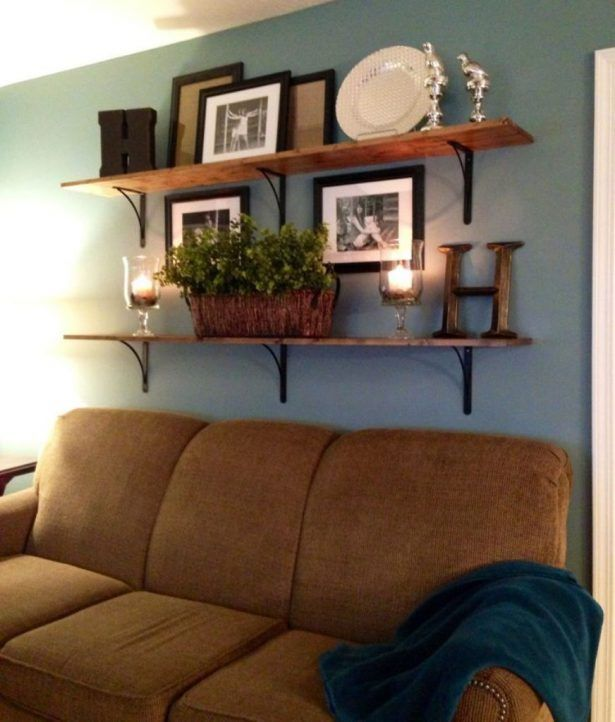 Family Room: Build Unique Statement Using Accessories For Family Room Decorating Ideas Blue Wall Color With Floating Wooden Shelves Using Decorative Pictures For Cozy Family Room Decorating Ideas With Brown Couch