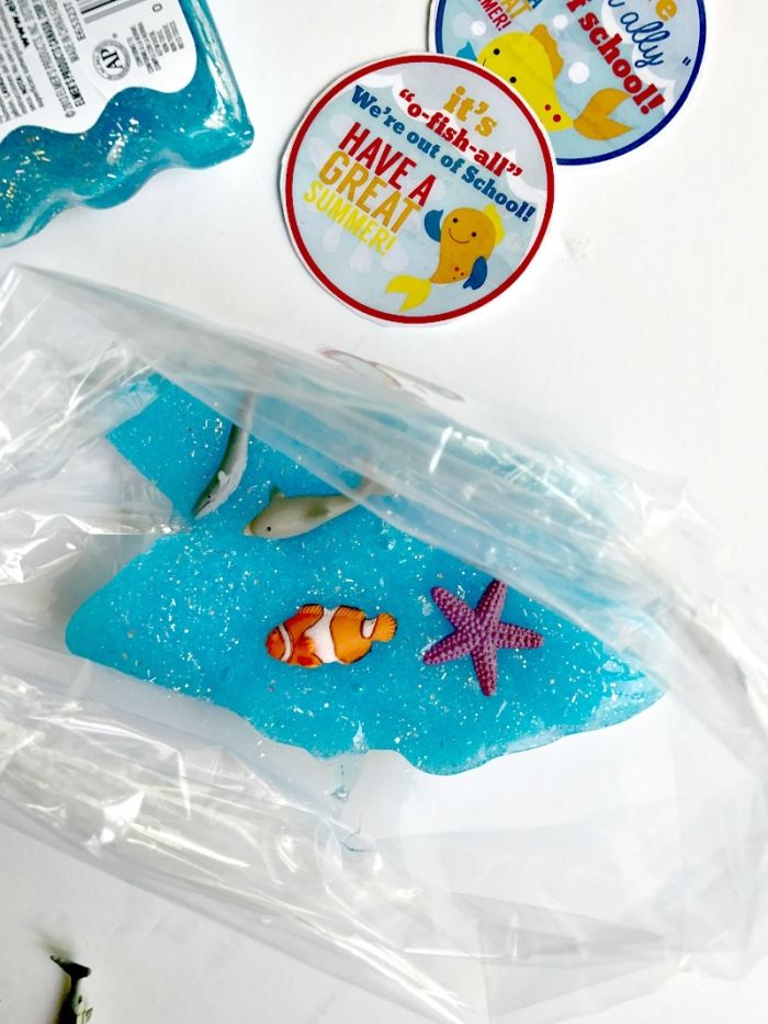 Fish Made Form Plastic And Some Glitter Decorating A Turquoise Piece Of Goo How To Make Slime With Shaving Cream Placed Inside Clear Bag
