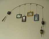Fishing Pole Picture Frame - What a great idea for that fisherman (or woman) in your life!! :)  I might actually have to try this one sometime!