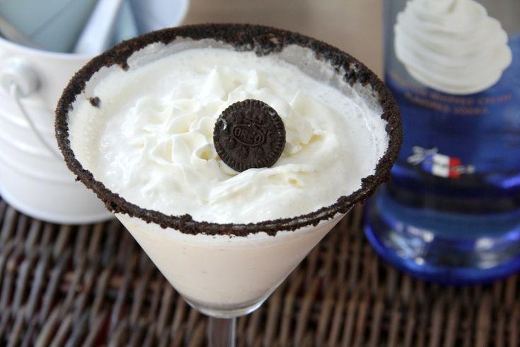 Cookies 'n Creamtini - - ◦1/3 cup milk or cream   ◦1/4 cup Pinnacle Whipped Vodka   ◦1 1/2 teaspoons JELL-O Oreo instant pudding mix   ◦Hershey's chocolate sauce   ◦Crushed Oreo crumbs   ◦Whipped cream   ◦1 mini Oreo