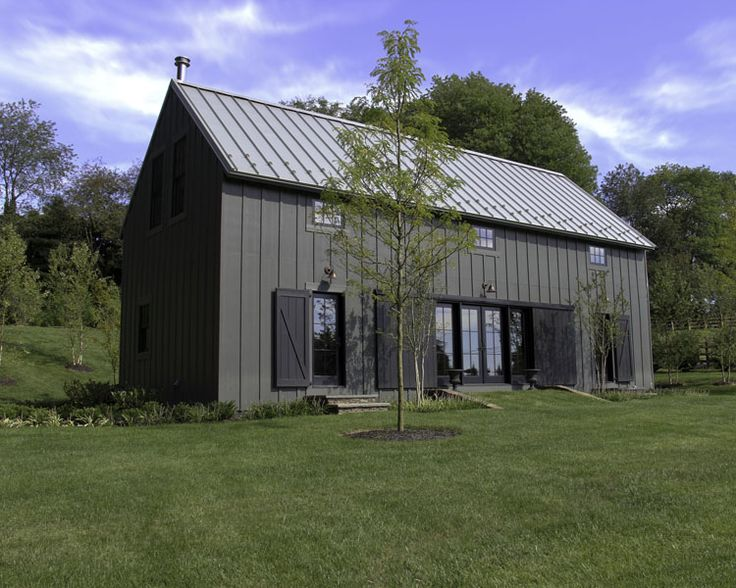 Simple modern home created in a rural vernacular.  Metal roof, Hardi Board Siding and Eagle windows.  Handmade pine doors complete the aesthetic.