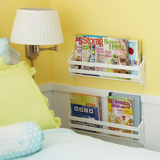 In a bedroom that is tight on space, eliminate the need for a side table by mounting the lamp and reading-material racks to the wall. Often called magazine racks, they'll sport eReaders and tablets, as well. Buy them unfinished at crafts stores and paint them to match the bedroom decor. Editor's Tip: Mount the racks to wall studs for stability. A corner shelf for water would work too.