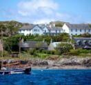 St Columba Hotel Iona Scotland and the Iona Abbey, Scotlands most famous Abbey.  You must take Caledonian MacBrayne ferry to Craignure on Mull (45 mins).  then Cal-Mac ferry to Iona to get here.. No vehicle traffic on Iona. You arrive by ferry and walk up a hill to the hotel.  the hotel does have an old station wagon they drive down to the ferry to pick up hotel guests luggage.  if you are just visiting the isle to see the Abbey, you will have to walk to the Abbey.  The views are incredible…