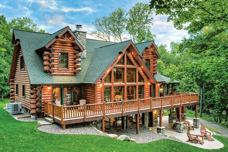 A hybrid half-log home in Wisconsin mixes materials into a home that enchants.