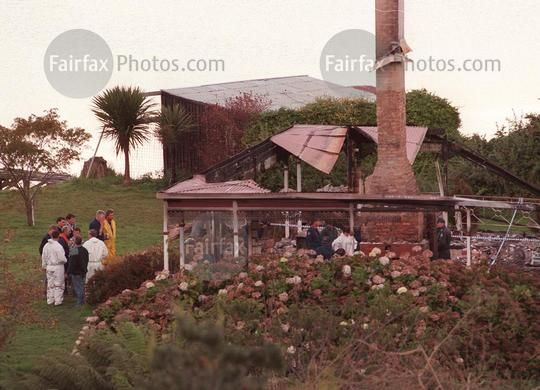 Police investigate in the ruins of the Seascape Guesthouse, where gunman Martin Bryant retreated after shooting and killing 35 people at the Port Arthur historic site, before setting fire to the building, 2 May 1996. SMH Picture by DALLAS KILPONEN