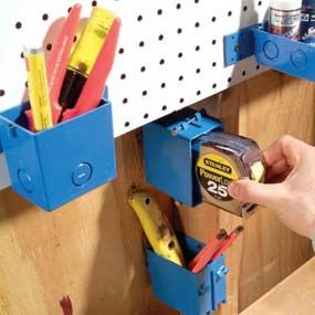 Electrical box tool holders...  Junction boxes can hold a lot more than switches and wiring. Nail or screw them wherever you need handy holders for small stuff. They come in different sizes and shapes and cost 50¢ to 2 dollars each.