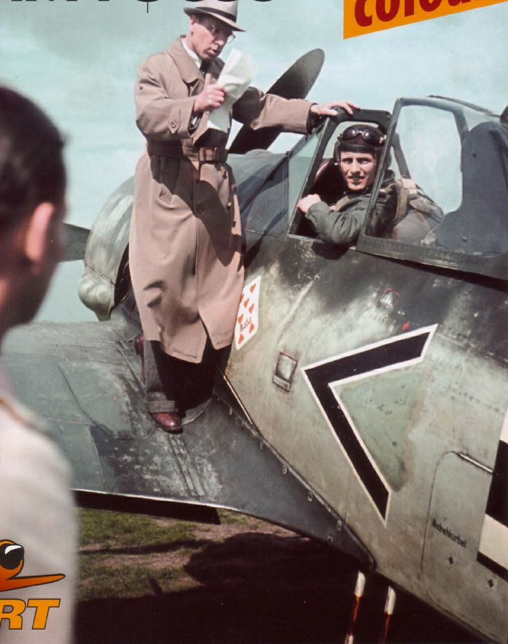 Oberingenieur Rudolf Blaser on the wing of a Focke-Wulf Fw 190 A-2 bearing the tactical marking < + I. This aircraft, Wernummer 20206, was flown by Oberfeldwebel Walter Grünlinger, wingman of the Gruppenkommandeur Hauptmann Josef Priller. Grünlinger had apparently just returned from a combat mission when this photograph was taken, and Blaser is seen explaining some technical aspects of the aircraft. Luftwaffe Day Aces, Luftwaffe Oberfeldwebel, NS Scientists