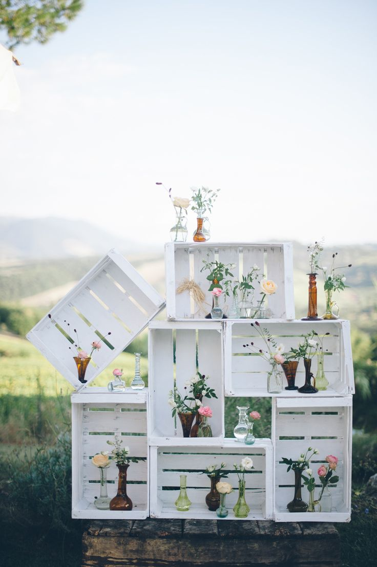 Crates filled with blooms | Photography: Lelia Scarfiotti - leliascarfiotti.com Read More: http://www.stylemepretty.com/little-black-book-blog/2014/05/09/romantic-al-fresco-umbria-wedding/