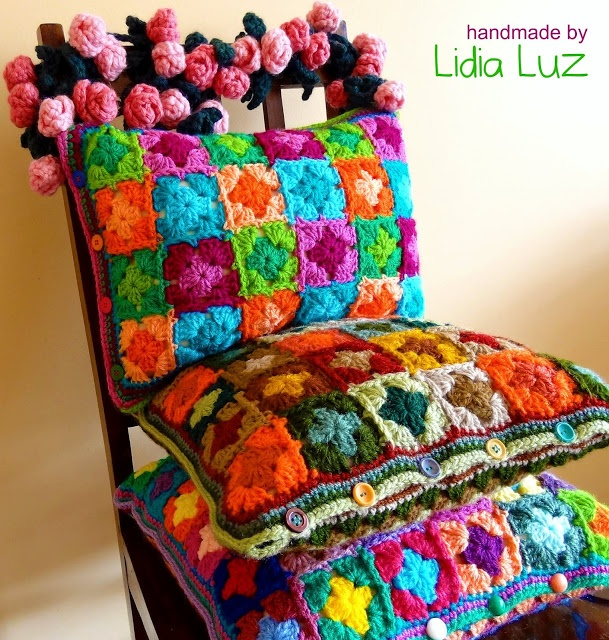 Lidia Light: Joy of living, crochet cushions--no instructions here, but very inspiring--and look at that garland of crocheted roses!!