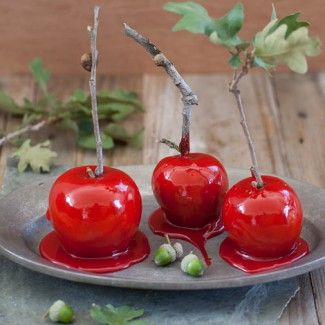 Talk about a pop of color! Red dipped candy apples recipe. Perfect for Halloween.