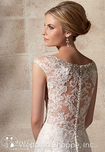 Stunning sheer lace back with covered buttons. Mori Lee Bridal Gown 2702