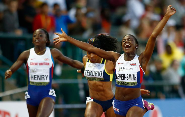 Dina Asher-Smith of Great Britain celebrates her win in the 100m Final against. Ángela Tenorio of Ecuador and Desiree Henry of Great Britain during day two of the IAAF World Junior Championships at Hayward Field on July 23, 2014 in Eugene, Oregon.