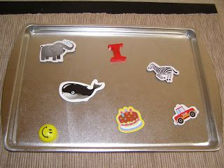 Toddler entertainment for a car ride: small cookie sheet with magnets (big enough so D can't swallow)