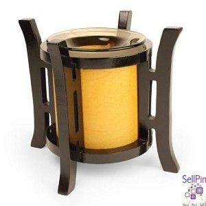 """SellPin.com: Pins for Sale by Owner: This Asian lantern style oil warmer measures 6.5"""" tall and 6.25"""" diameter. Orange cylinder with bronze tinted dish for the oil. Uses one 35 watt halogen bulb (included). You can use either scented oils or tarts in this oil warmer. The 36"""" power cord has a built in dial that allows you to adjust the heat and light. Turn it up to use as a lamp, turn it down for use as a night light. Attractive design compliments any style or decor. $18"""