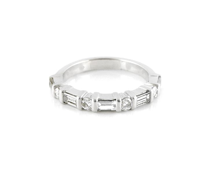 An 18ct White Gold and Diamond Eternity Rings
