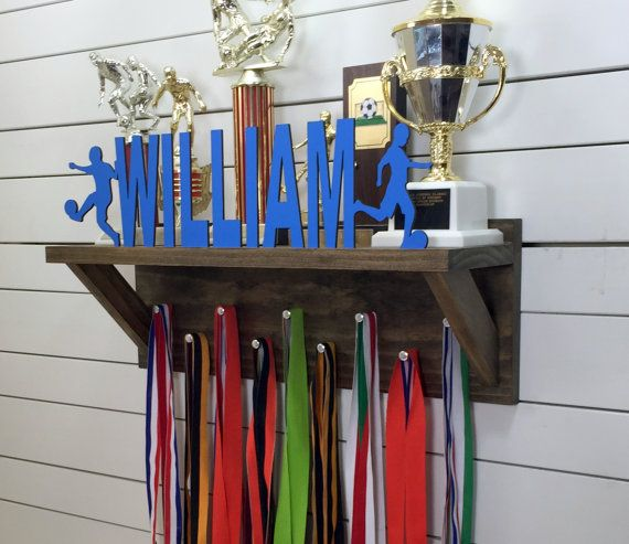 This personalized wood trophy shelf and medal holder is the best way to display all the hardware youve been collecting on the circuit. Available in