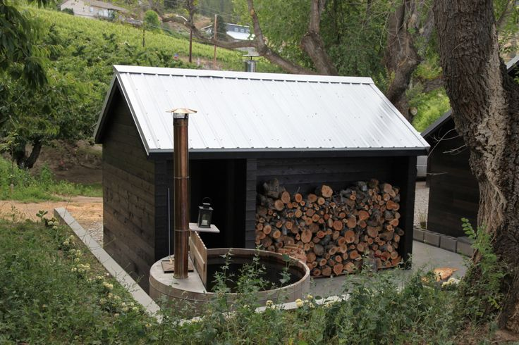 Wood-burning sauna and Snorkel tub in Naramata, BC, Canada. Its surrounded by a five acre organic orchard of cherries, apples, pears and apricots called Picker Shack.