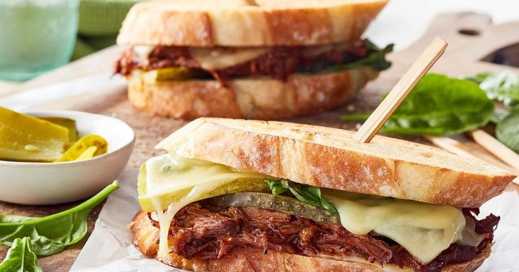 Take a few a shortcuts with this fully-loaded beef brisket toastie, topped with vintage cheddar, pickled cucumber and spinach leaves.