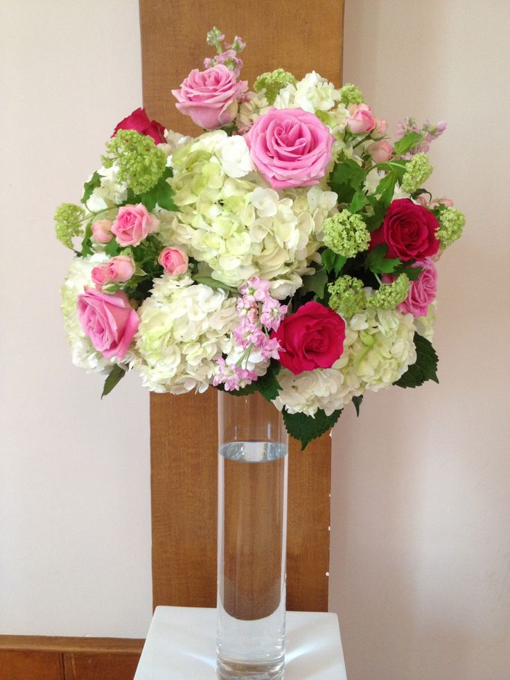 Altar pieces of hydrangea, roses, spray roses, stock and viburnum for the perfect ceremony backdrop