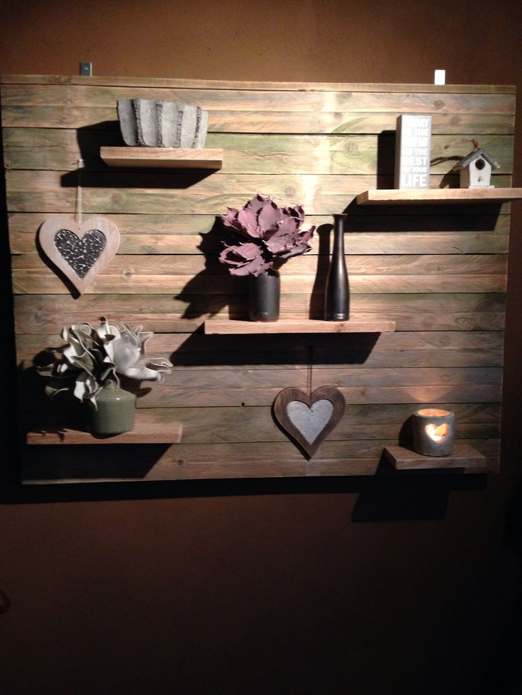 Display on the wall made from pallets with integrated shelves.