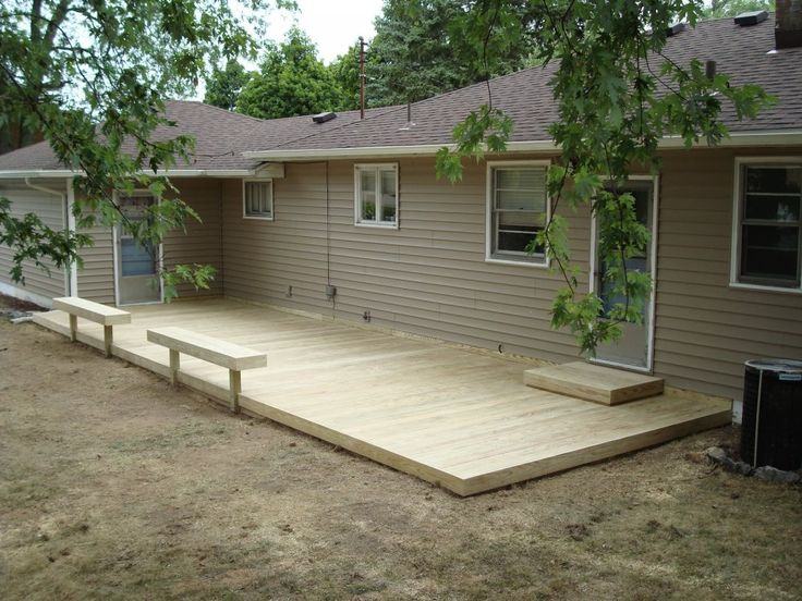 small ground-level decks | Here's a ground level deck with a lattice privacy wall.