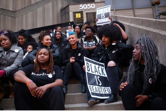 """Protesters with """"big, beautiful black hair"""" assemble for a photo at the start of a Black Lives Matter protest in front of the TDSB building on Yonge St. in North York on Friday evening. Cole Burston/Toronto Star"""