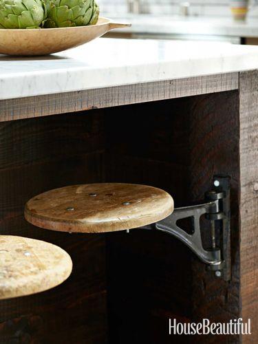 Swivel stools under kitchen island -Unique Kitchen Storage Ideas - Kitchen Organization Tips - House Beautiful