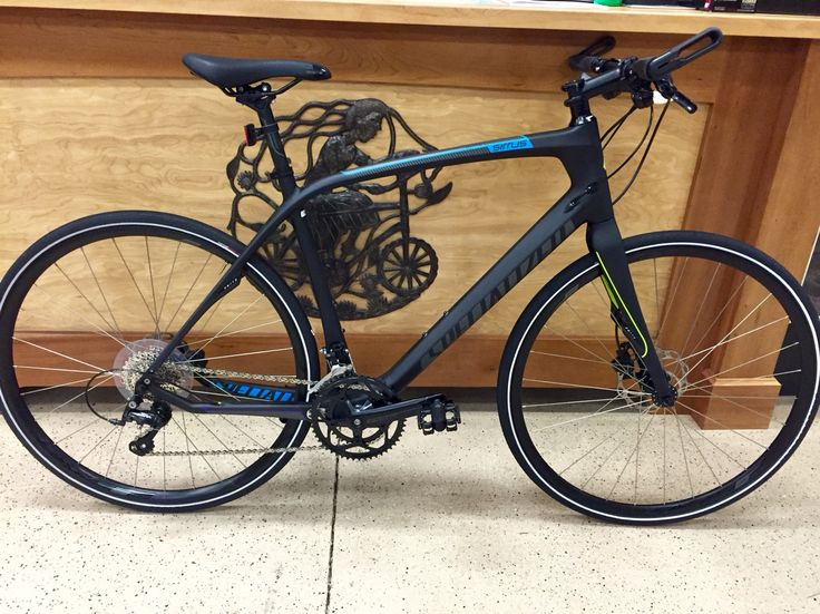 "2015 Specialized Sirrus Elite Carbon Disc. Really sweet flat bar road bike. Size ""L"". $1500."