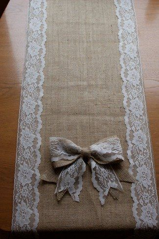 Burlap and lace table runner .. you could use this any time of year by using different color flowers, candles, china , crystal etc !