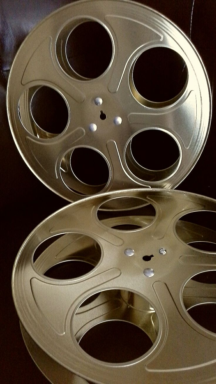 """gold movie reels for centerpiece décor for an """"Old Hollywood"""" themed Prom; design by Davis Floral Creations"""