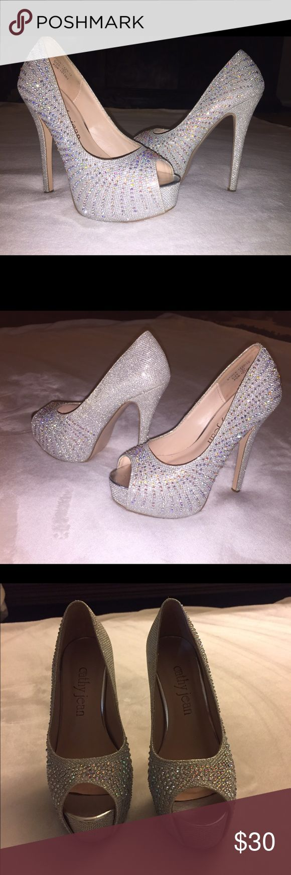 Cathy Jean silver heels Size 5 Cathy jean silver peep toe heels true to size. I used them once for prom, they honestly make your outfit look amazing. Rhinestones are intact. Only sign of wear is on soles. They are perfect for any special occasion Cathy Jean Shoes Heels