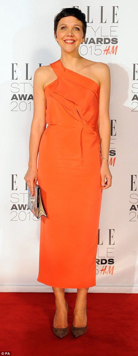 Zesty! Actress Maggie Gyllenhaal wore a bright orange dress and autumnal brown suede heels...