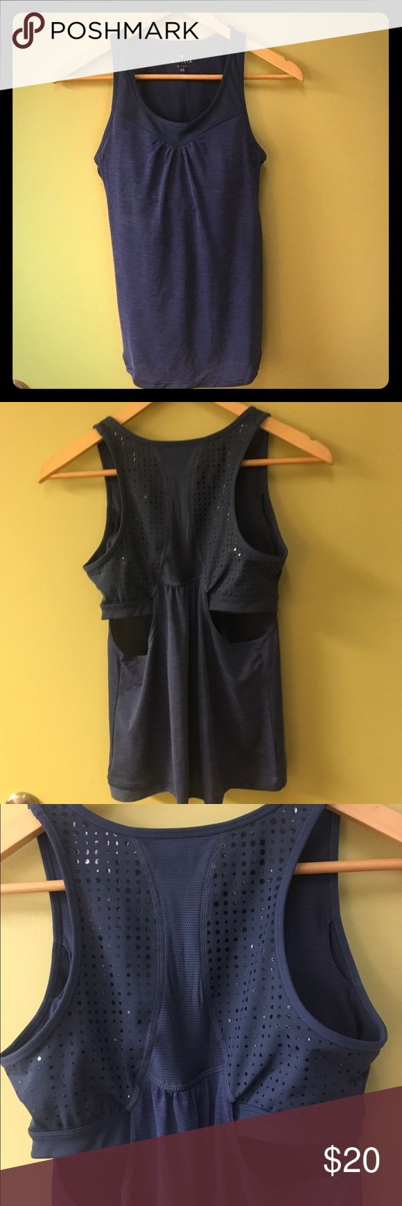Athleta XS work out top. NWOT! NWOT! XS Slate blue Athleta work put top built in bra, with side cut out for ventilation. Never worn. Great quality breathable material, outer shell has tiny holes for cooling effect. True Athleta performance style! Athleta Tops Tank Tops